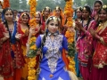 . Amritsar (India), 08/08/2015.- Indian women from the women's Khalsa College, wearing traditional Punjabi attire pose for a photograph during an event to celebrate Teej Festival in Amritsar, India, 08 August 2015. Teej festival is celebrated during the Saawan month which falls in July-August. The folk songs the women and girls sing are dedicated to their husbands or to-be-husbands, symbolizing the true love and sacrifical nature of Punjabi women for their love. EFE/EPA/RAMINDER PAL SINGH